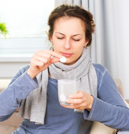 aspirin: Ill Woman Taking Aspirin Pills  Headache