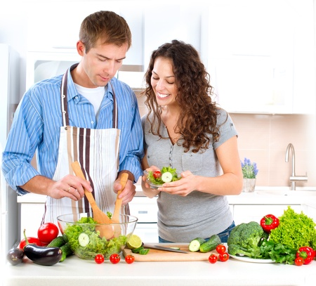 healthy person: Happy Couple Cooking Together  Dieting  Healthy Food  Stock Photo