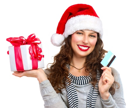 Christmas  Happy Smiling Woman with Gift Box and Credit Card  photo