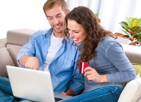 e shopping: Young couple with Laptop and Credit Card buying online