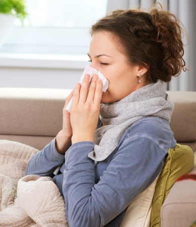 cold virus: Sick Woman Flu Woman Caught Cold  Sneezing into Tissue  Stock Photo