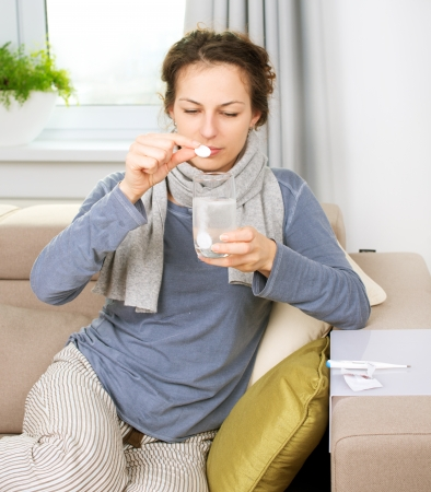 Ill Woman Taking Aspirin Pills  Headache Stock Photo - 16443973
