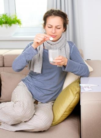 aspirin: Ill Woman Taking Aspirin Pills  Headache  Medicine Stock Photo