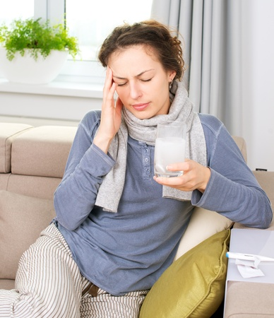 Ill Woman Taking Aspirin Pills Headache Stock Photo - 16443979