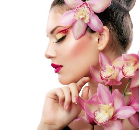 Szépség portré szép elegáns lány orchidea virág Stock fotó