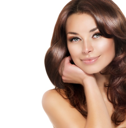 Beautiful Brunette Woman Portrait with healthy Hair Stock Photo