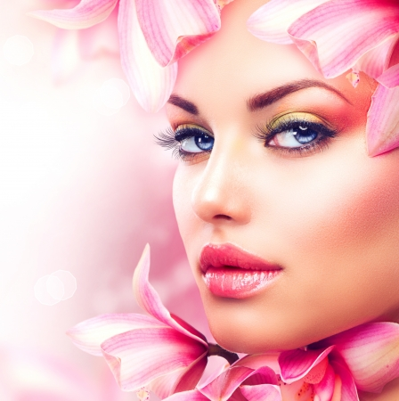 Beautiful Girl With Orchid Flowers  Beauty Woman Face Фото со стока - 16472442