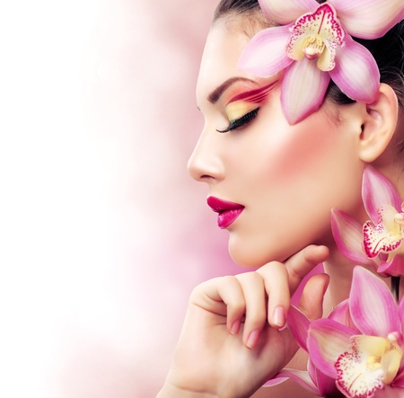 Beautiful Girl With Orchid Flowers  Perfect Make-up Stock Photo - 16472443