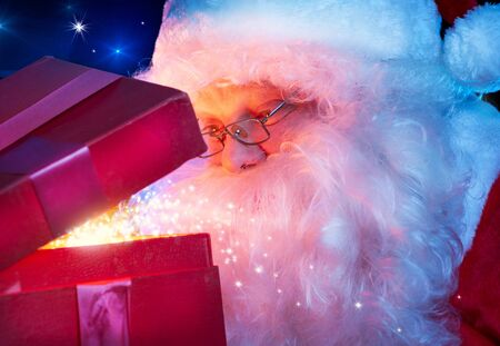 Santa Claus with Magic Christmas Gift  photo