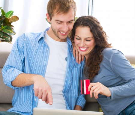 Young couple with Laptop and Credit Card buying online Stock Photo - 16472459