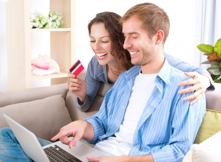 buying: Young couple with Laptop and Credit Card buying online