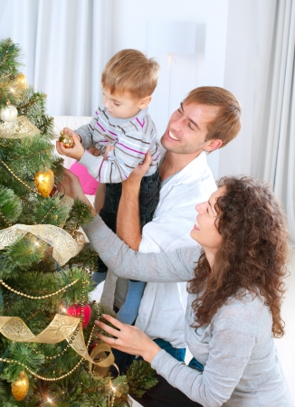Young Family decorating a Christmas Tree  photo