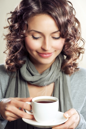 Beautiful Woman drinking Coffee or Tea  photo