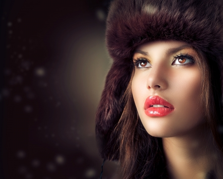 Beautiful Young Woman in a Fur Hat  Winter Style  photo