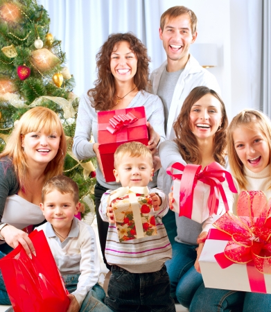 decorating christmas tree: Happy Big Family with Christmas Gifts at Home