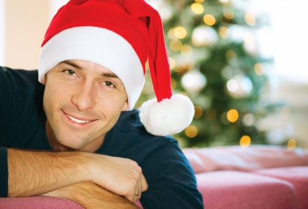 Handsome Young Man wearing Santa s Hat  Christmas Guy Portrait Stock Photo - 16717245