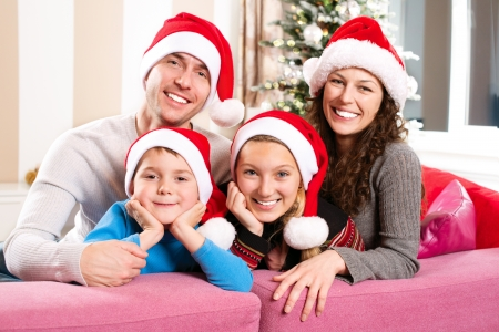 family living: Christmas Family with Kids  Happy Smiling Parents and Children