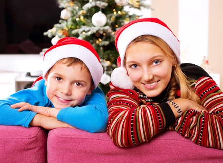 Christmas Children  Happy Kids wearing Santa s Hat  photo