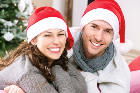 Christmas Couple wearing Santa s Hat  photo