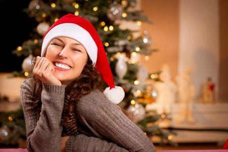Christmas Woman in Santa Hat  Happy Smiling Girl  photo