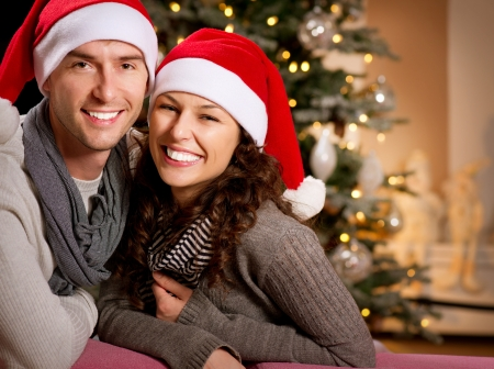 fireplace family: Christmas  Happy Couple at home celebrating Christmas