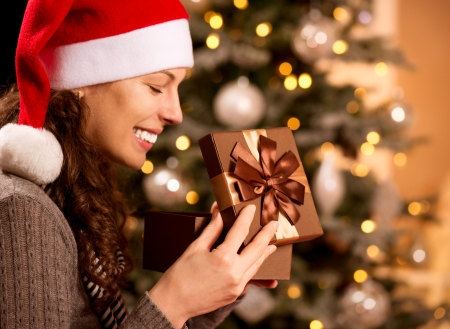 opening gift: Christmas  Happy Surprised Woman opening Gift box Stock Photo