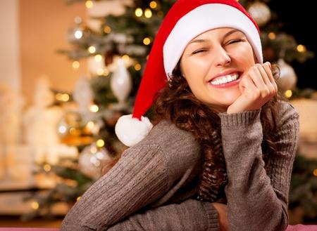 Christmas Woman in Santa Hat  Happy Smiling Girl Stock Photo - 16717243
