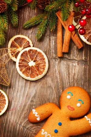 Christmas Holiday Background  Gingerbread Man over Wood  photo