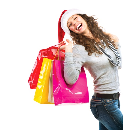 christmas shopping: Christmas Shopping  Woman with Bags over White  Sales