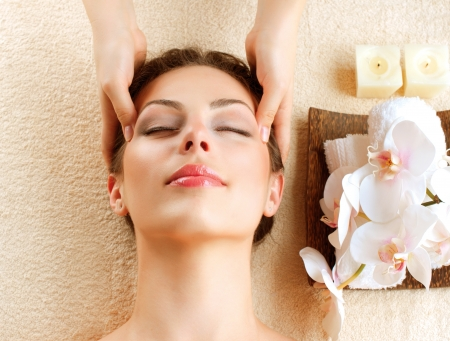 spa facial: Spa Massage  Young Woman Getting Facial Massage