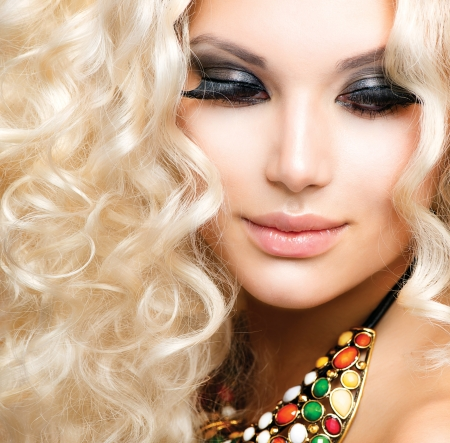 beauty salon face: Beautiful Girl with Curly Blond Hair  Stock Photo