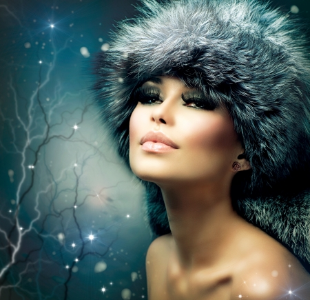 Winter Christmas Woman Portrait  Beautiful Girl in Fur Hat  photo