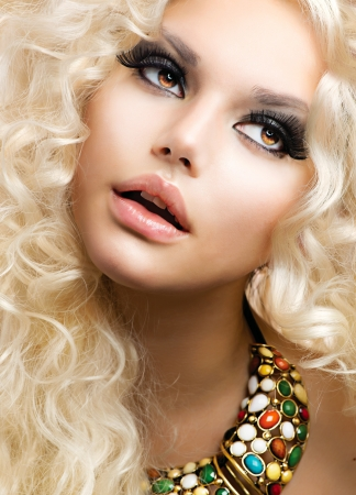make up eyes: Beautiful Girl with Curly Blond Hair  Stock Photo