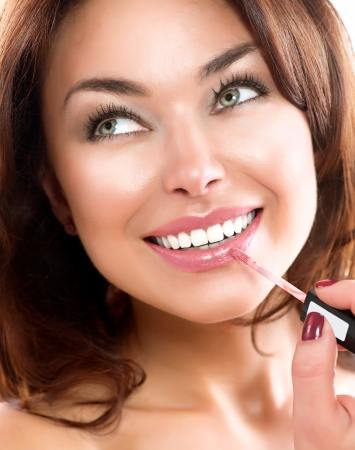 wet lips: Beauty Girl Applying Lipgloss  Makeup  Beautiful Woman s Face
