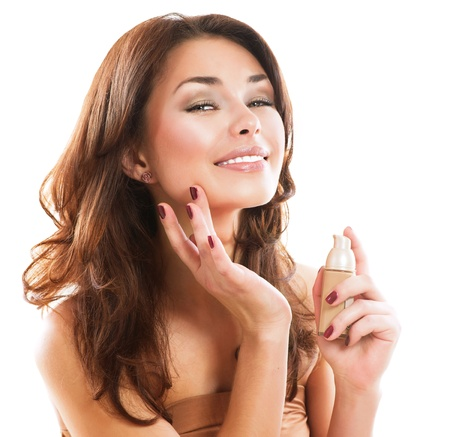 moisturize: Foundation  Beautiful Woman Applying Make-up  Stock Photo
