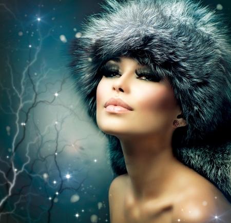 silver fox: Winter Christmas Woman Portrait  Beautiful Girl in Fur Hat  Stock Photo