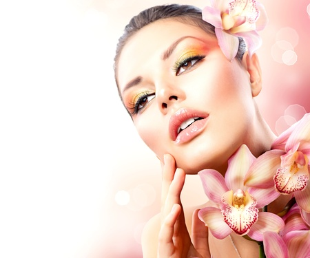 Beautiful Spa Girl With Orchid Flowers Touching her Face Stock Photo - 17535785