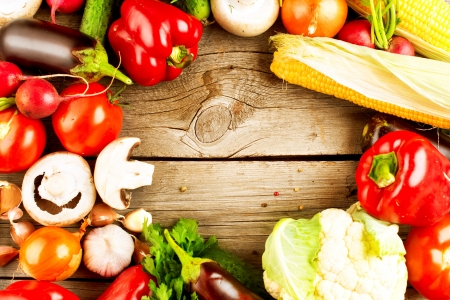 Healthy Organic Vegetables on the Wooden Background  Stock Photo - 17508984