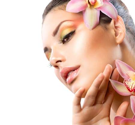 eyeshadows: Beautiful Spa Girl With Orchid Flowers Isolated on White  Stock Photo