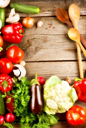spoon yellow: Healthy Organic Vegetables on a Wood Background