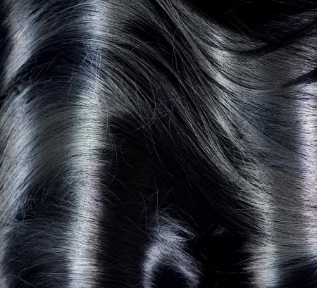 černé vlasy: Černé vlasy pozadí dlouhými tmavými vlasy Texture Reklamní fotografie