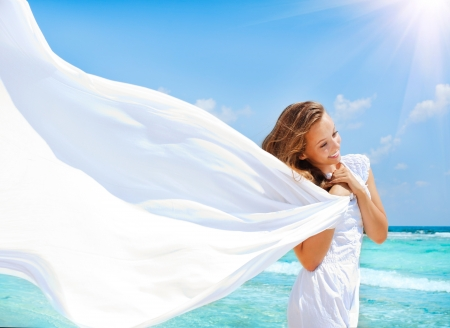 woman beach dress: Beautiful Girl With White Scarf on The Beach