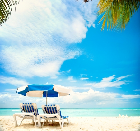 vacation destinations: Vacation and Tourism concept  Sunbeds on the paradise beach  Stock Photo