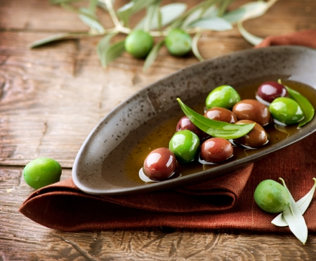restaurant setting: Olives and Olive Oil  Stock Photo
