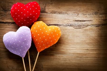 st valentine day: Valentines Vintage Handmade Hearts over Wooden Background