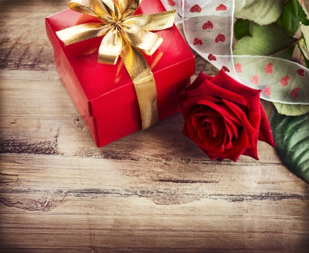 Valentine  Rose Flower and Gift Box over Wooden Background  photo