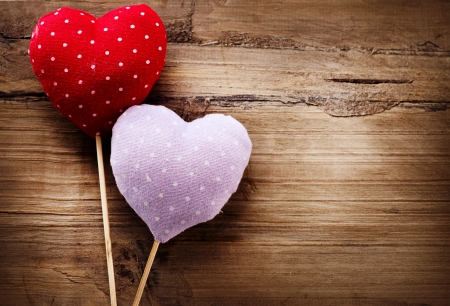 Valentines Vintage Handmade Hearts over Wooden Background  photo