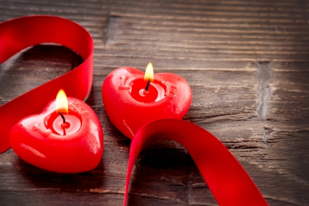 candle flame: Valentines Hearts Candles over Wood  Valentine s Day Stock Photo