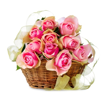 Roses in the Basket isolated on a White Background  photo