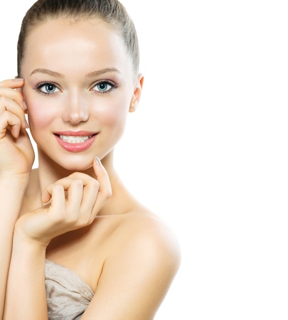 Beautiful Young Woman with Fresh Clean Skin touching her Face Stock Photo - 17935512